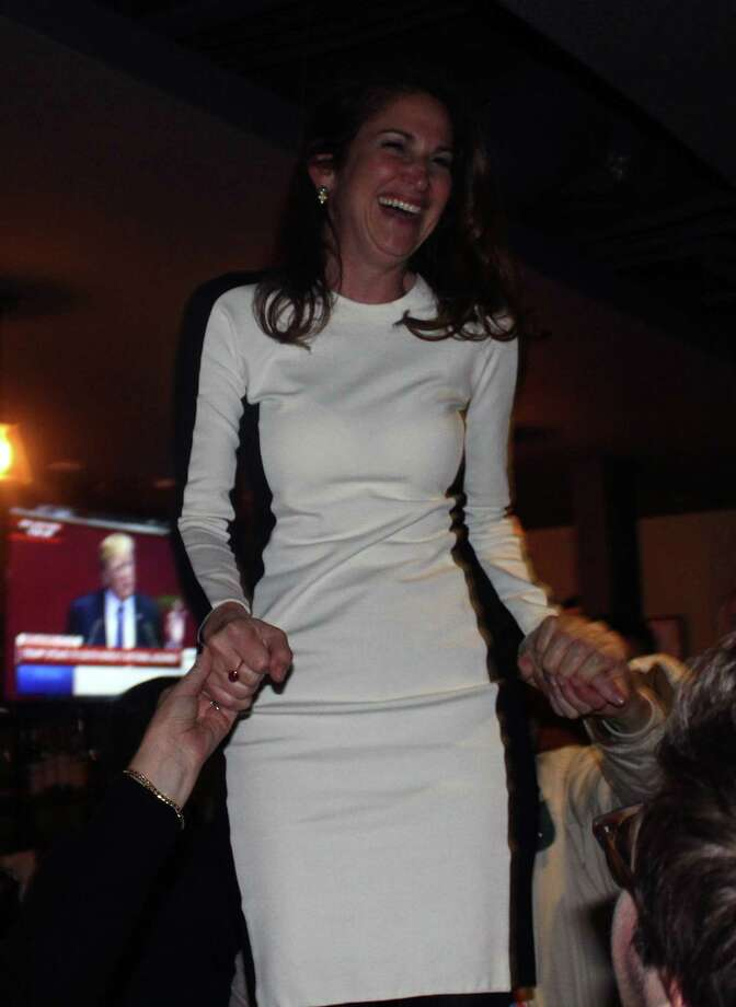 Democratic First Selectman candidate Melissa Kane speaks stands on a chair at The 'Port restaurant in Westport embracing supporters after hearing of her loss to Republican First Selectman Incumbent Jim Marpe. Photo: Sophie Vaughan/Hearst Connecticut Media
