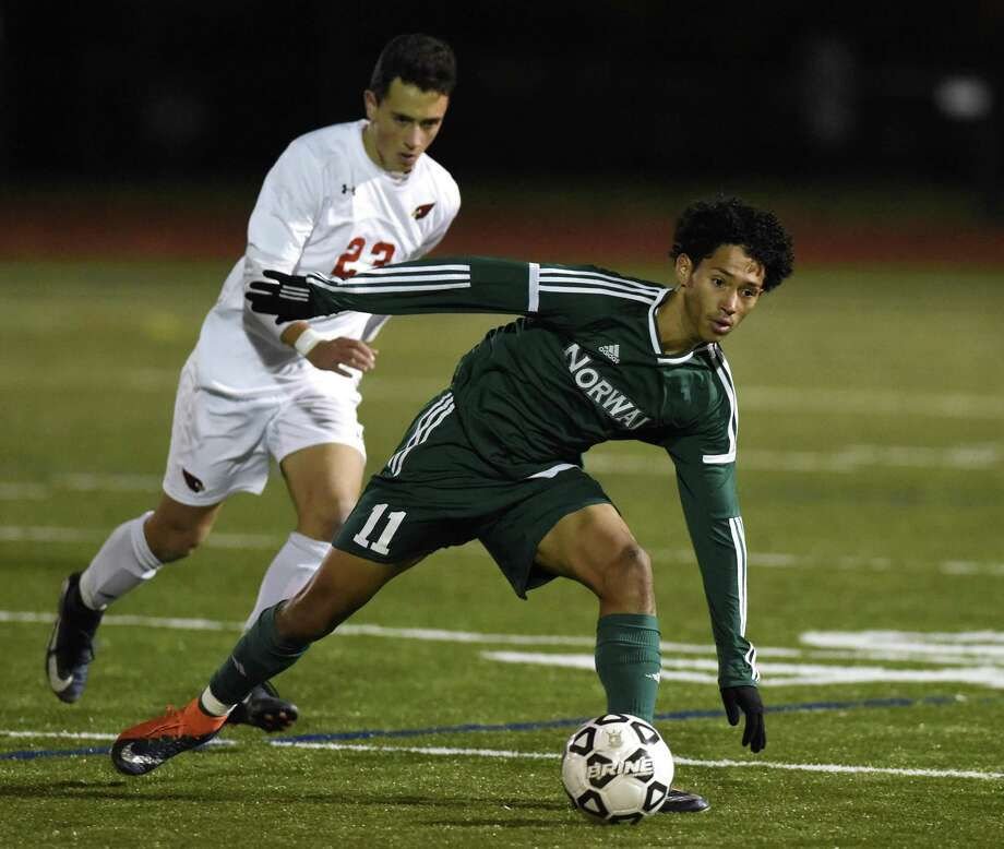 Norwalk's Michael Hidalgo, right, shown here in a FCIAC semifinal game against Greenwich, had a goal and an assist in a 2-1 win over Warde on Wednesday. Photo: Tyler Sizemore / Hearst Connecticut Media / Greenwich Time