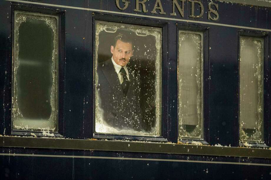 "This image released by Twentieth Century Fox shows Johnny Depp in a scene from, ""Murder on the Orient Express."" (Nicola Dove/Twentieth Century Fox via AP) ORG XMIT: NYET814 Photo: Nicola Dove / TM & © 2017 Twentieth Century Fox Film Corporation. All Rights"