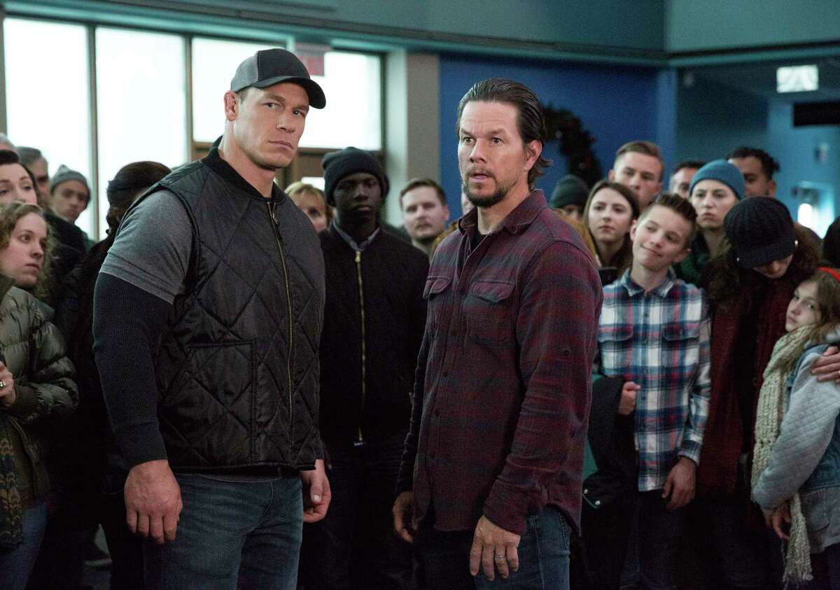 This image released by Paramount Pictures shows John Cena, left, and Mark Wahlberg in