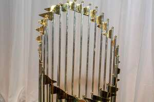 The World Series trophy displayed at One Great Night in November, MFAH's annual men-only event at the Museum of Fine Art Houston.   (For the Chronicle/Gary Fountain, November 8, 2017)