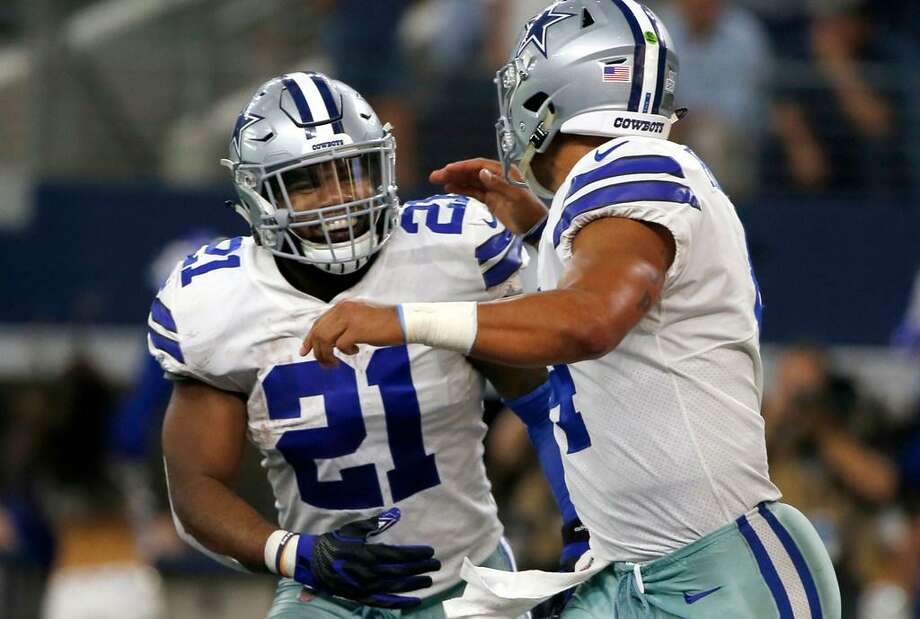 In this Oct. 8, 2017, photo, Dallas Cowboys' Ezekiel Elliott (21) and quarterback Dak Prescott (4) run off the field celebrating during a game against the Green Bay Packers in Arlington, Texas. Elliott lost a legal battle Thursday and will being serving a six-game suspension this week. Photo: Ron Jenkins /AP Photo