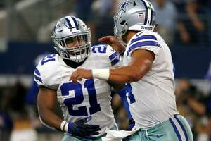 In this Oct. 8, 2017, photo, Dallas Cowboys' Ezekiel Elliott (21) and quarterback Dak Prescott (4) run off the field celebrating during a game against the Green Bay Packers in Arlington, Texas. Elliott lost a legal battle Thursday and will being serving a six-game suspension this week.