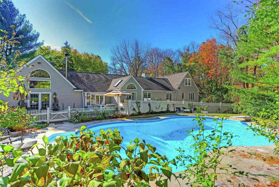 The colonial-style house at 44 Middlebrook Farm Road features 15 rooms, 5,621 square feet of living space, an in-ground swimming pool, outdoor shower, and mahogany deck. Photo: Contributed Photos