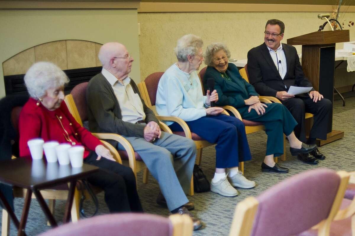 Floyd Andrick, right, hosts a panel of Midland centenarians on Thursday, Nov. 9, 2017 at the Herbert D. Doan Midland County History Center. From left are Rhea Currie, 101, Howard Shaver, 100, Frieda Milano, 100, and Rosa Miller, 100. (Katy Kildee/kkildee@mdn.net)
