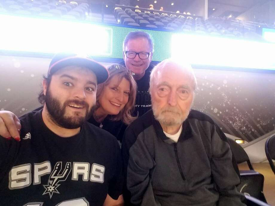 Glen Erp, surrounded by his family, at the last Spurs game he was able to attend in March 2017.
