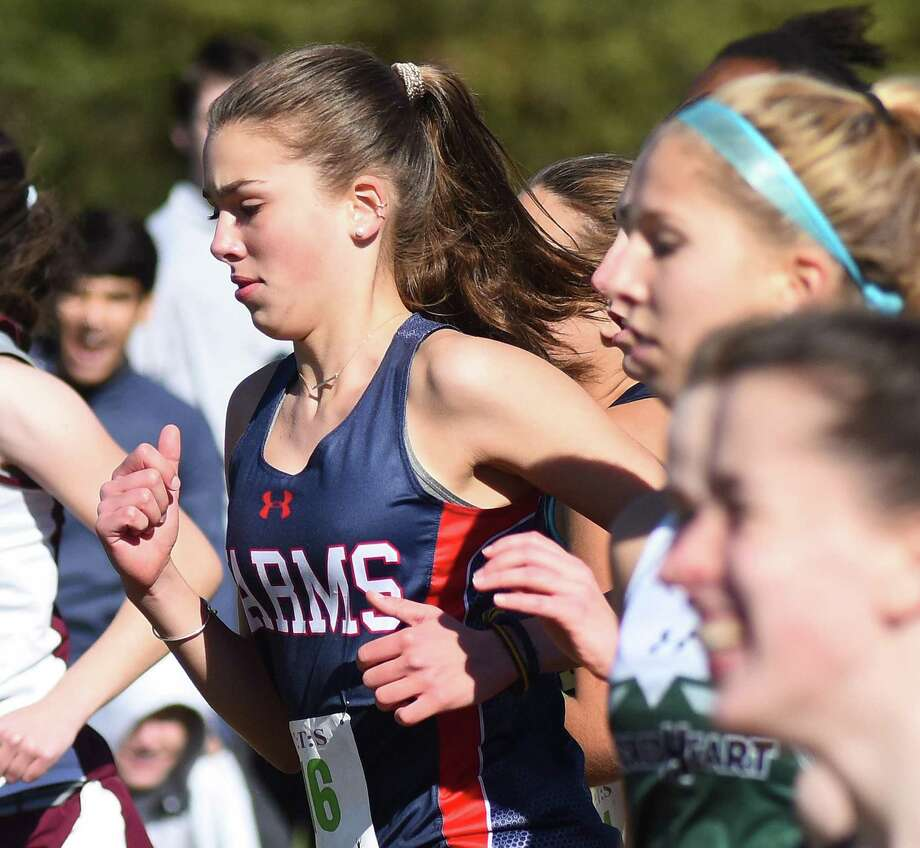 GFA freshman Caroline McCall, a resident of Westport, runs from the starting line during last week's FAA XC championship race at Waveny Park in New Canaan. McCall finished 11th overall to earn All-FAA Honorable Mention honors. Photo: Contributed Photo