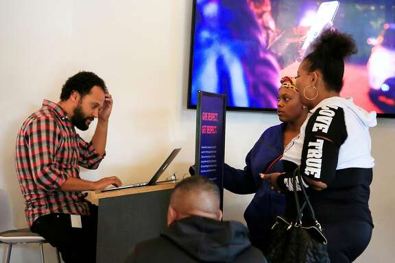 Breno Casal Santos (l to r), Lyft community associate, assists Tatiana Chilton and Krystle Edwards at the Lyft Hub on Thursday, November 9,  2017 in San Francisco, Calif.