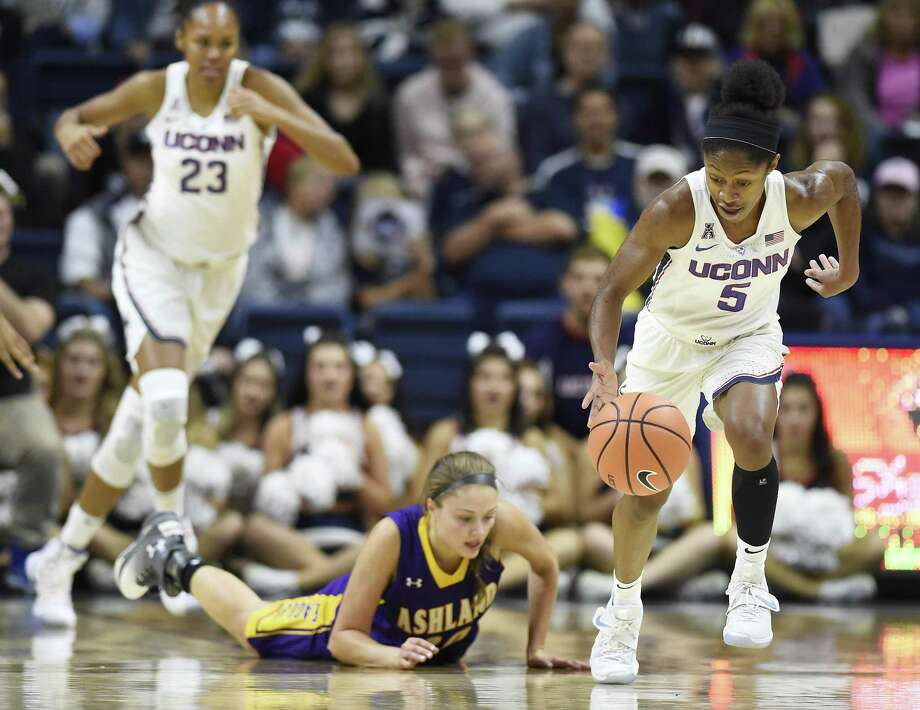 UConn's Crystal Dangerfield (5) steals the ball from Ashland's Maddie Dackin (20), during an exhibition game on Sunday. Photo: Jessica Hill / Associated Press / AP2017