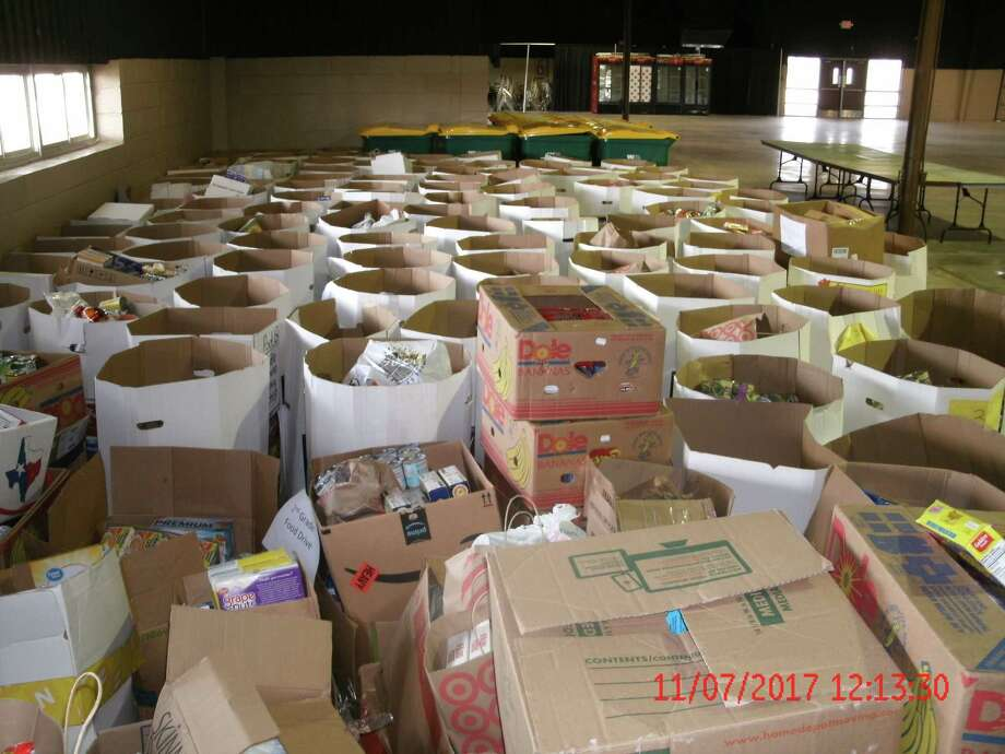 More than 25,000 pounds of donated food await sorting in this year's Can Do Food Drive.