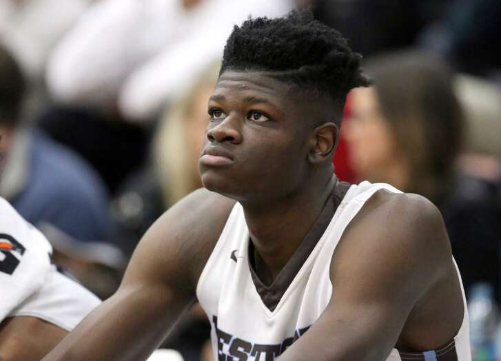 Westtown School's Mo Bamba watches from the bench during a Jan. 14, 2017 high school game against Hillcrest Prep at the 2017 Hoophall Classic in Springfield, Mass.