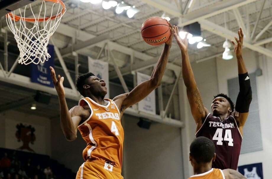 Texas forward Mohamed Bamba (4) grabs a rebound from Texas A&M forward Robert Williams (44) during an Oct. 25, 2017 college basketball charity game in Houston to benefit the Rebuild Texas Relief Fund. Photo: Tim Warner /Houston Chronicle
