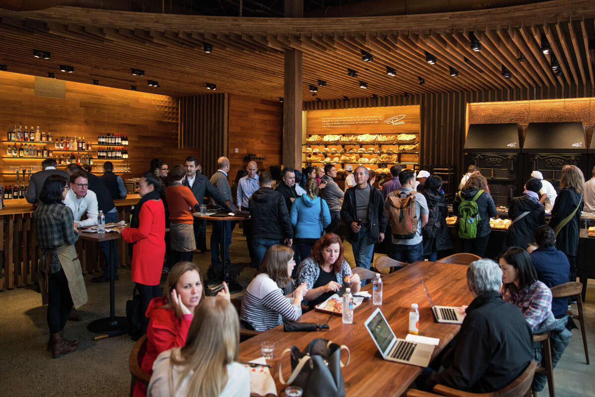 A crowd fills Rocco Prince's new bakery at Starbucks Reserve Roastery in Capitol Hill on Thursday, Nov 8, 2017.