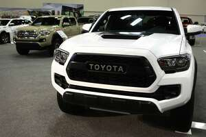 Among the vehicles that crowds can check out are the new Toyota Tacomas. More than 100,000 people are expected to attend the event, which ends Sunday.