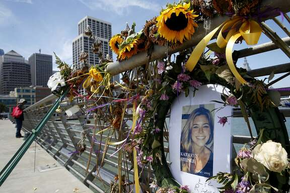 FILE - In this July 17, 2015 file photo, flowers and a portrait of Kate Steinle remain at a memorial site on Pier 14 in San Francisco. San Francisco jurors heard the muddled confession of the Mexican national on trial for the fatal shooting of Kate Steinle, whose death touched off a fierce debate over immigration. On Wednesday, Nov. 1, 2017, prosecutors played a portion of the interrogation of Jose Ines Garcia Zarate recorded several hours after Steinle was shot on July 1, 2015. (Paul Chinn /San Francisco Chronicle via AP, File)