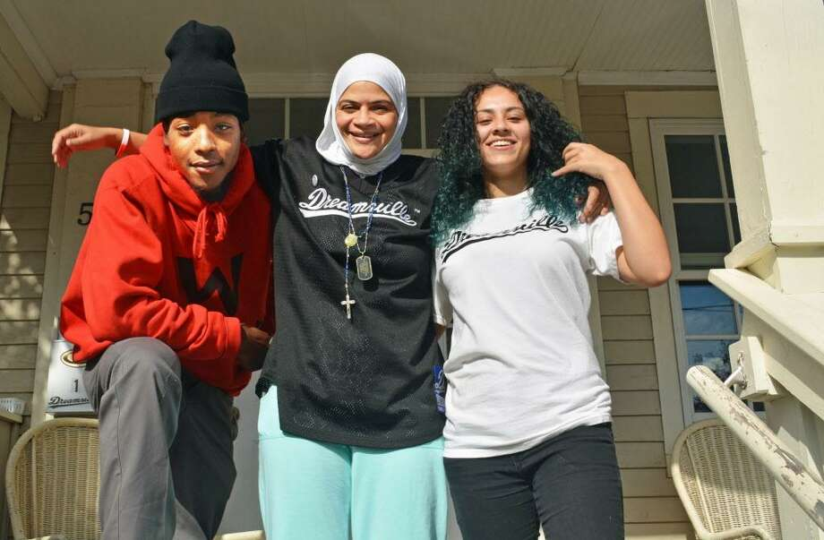 Nur Fitzpatrick, center, has been helping Dwayne, 23, left, and Angie, 16, along with several other homeless young people in Middletown. Photo: Cassandra Day / Hearst Connecticut Media