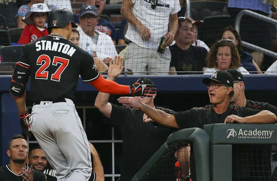 Miami's Giancarlo Stanton (27) is greeted by manager Don Mattingly last season. Mattingly will be back in 2018. Photo: John Bazemore, Associated Press