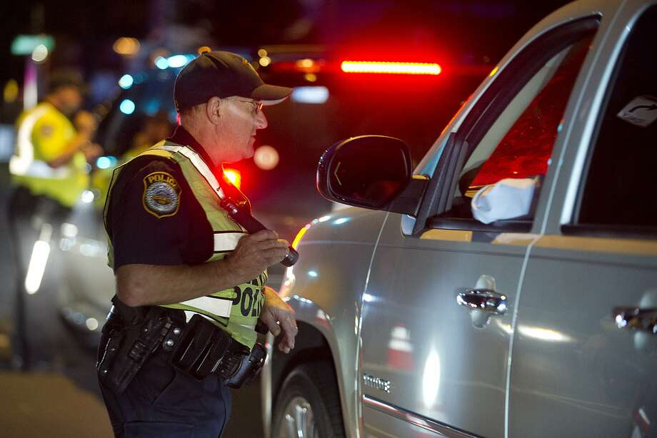 Police officer conducts a DUI stop. Photo: Lindsay Perry