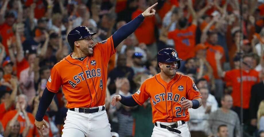 Houston Astros center fielder George Springer (4) points towards Carlos Correa at second base who had just drove in Springer and Altuve on a two-run double in the sixth inning of Game 2 of the ALDS at Minute Maid Park on Friday, Oct. 6, 2017, in Houston. ( Karen Warren / Houston Chronicle ) Photo: Karen Warren/Houston Chronicle
