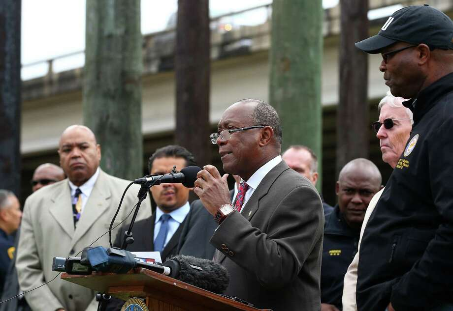 Mayor Sylvester Turner, center, speaks during a press conference addressing violence issues at the homeless encampment under the U.S. 59 Highway bridge Thursday, Nov. 9, 2017, in Houston. There's been a string of shootings and a stabbing in the past three months, including a homeless man who was shot and killed Tuesday night. ( Godofredo A. Vasquez / Houston Chronicle ) Photo: Godofredo A. Vasquez, Houston Chronicle / Godofredo A. Vasquez