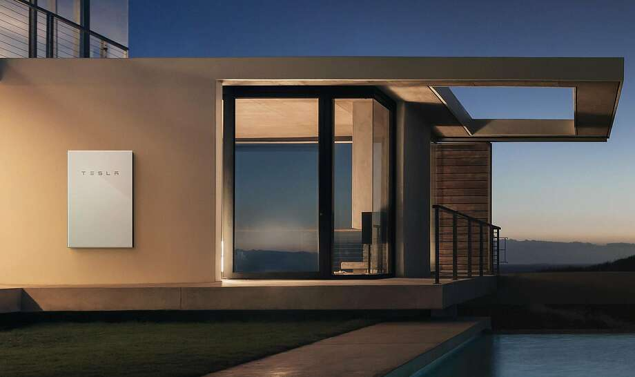 Tesla's Powerwall    2  is a big house battery that stores energy from solar panels. Photo: Photos Courtesy Of Tesla