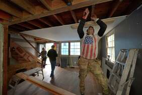 Jeff Detoro of American Home Builders works at the 1950s cape-style home flippers Jay and Leslie Vincentare renovating at 4 Chelene Road Wednesday, November 8, 2017, in Norwalk, Conn.