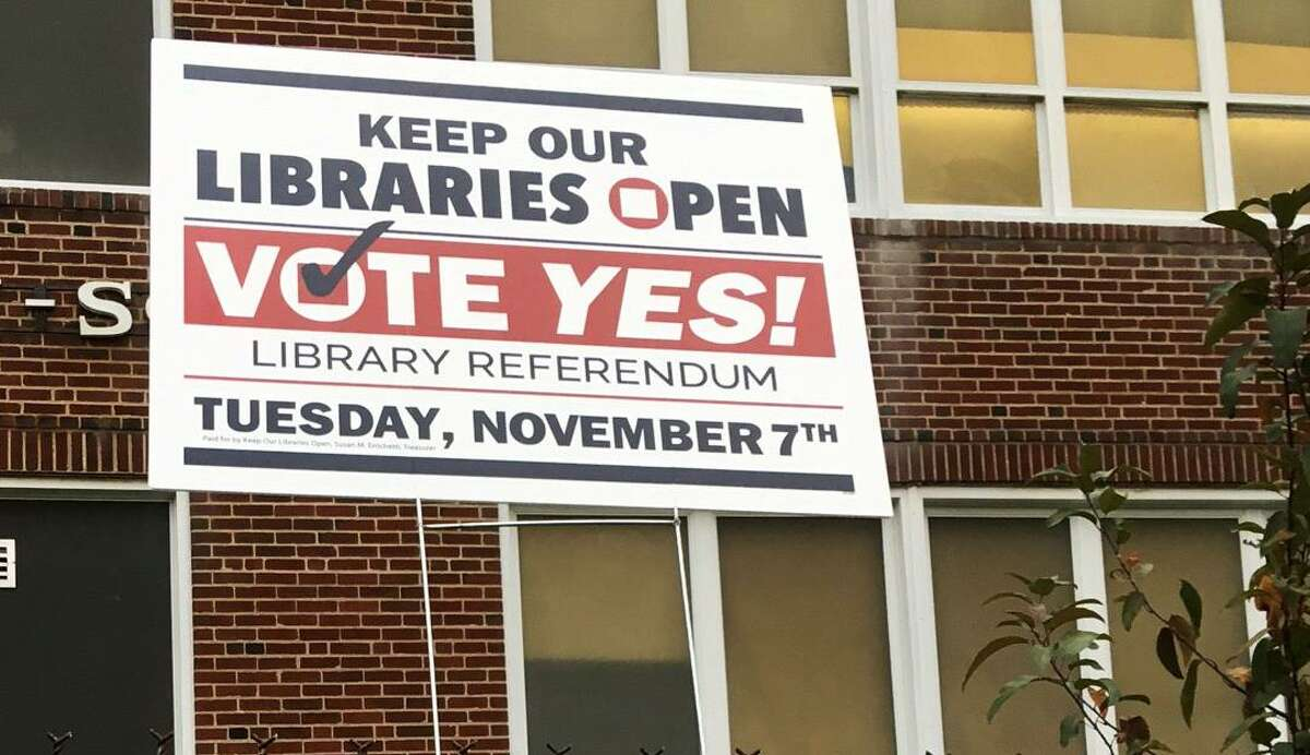 Voters in Bridgeport heeded a sign posted to the fence outside Hallen School on Omega Street in Bridgeport on Election Day, passing a referendum forcing the mayor to find roughly an additional $2 million in next year?'s budget for the library system.