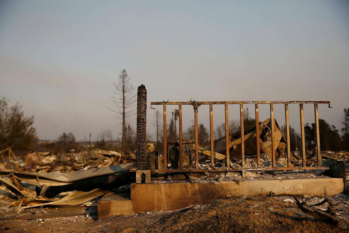A burned railing and post stand at the ruins of a home in the Coffey Park neighborhood after the Tubbs Fire, October 11, 2017 in Santa Rosa.
