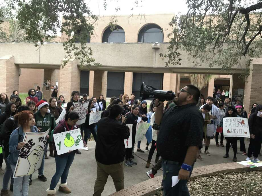 Josue Puente, 22, (right, with megaphone) leads chants for a group of about 100 students at the University of Texas Rio Grande Valley in Edinburg, Texas, on Thursday, Nov. 9, 2017. The students participated in a nationwide walkout and rally to urge Congress to pass a clean Dream Act that would give Deferred Action for Childhood Arrivals (DACA) recipients permanent residency and a path to citizenship. Puente is a student organizer with LUCHA, La Union Chicanx Hijxs de Aztlán. Photo: Photo By Aaron Nelsen / San Antonio Express-News