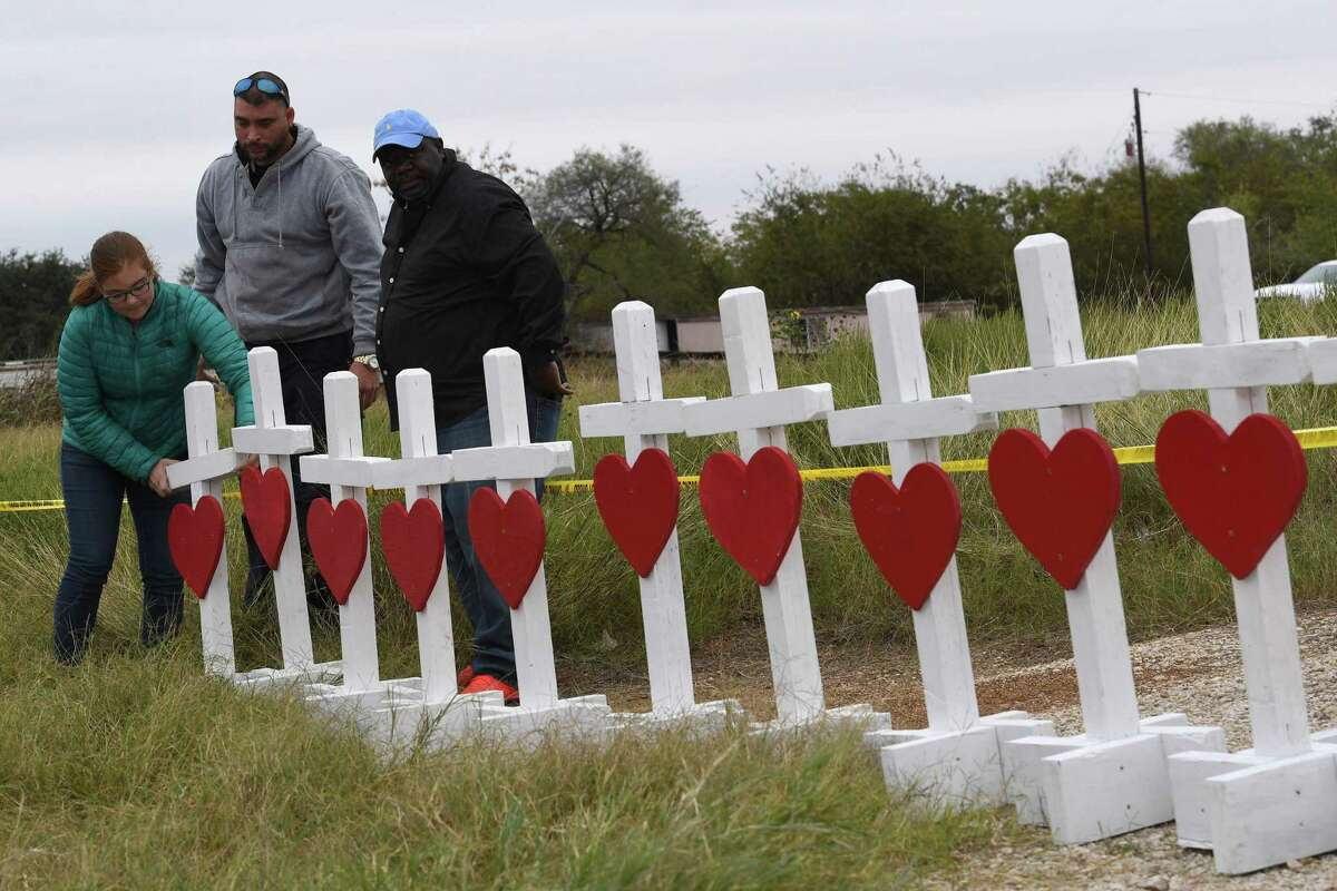 Crosses are erected Wednesday outside the First Baptist Church of Sutherland Springs, scene of Sunday's massacre that shocked the nation.