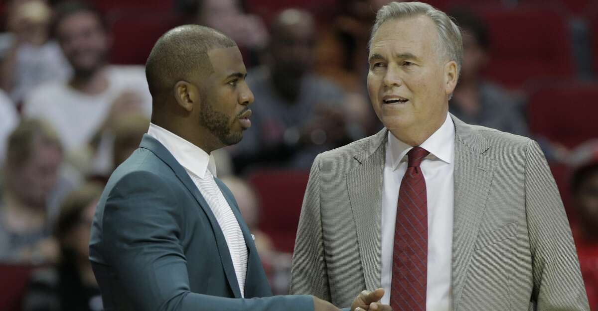 Houston Rockets guard Chris Paul (3) talks with Rockets head coach Mike D'Antoni during game action against the Philadelphia 76ers at the Toyota Center on Monday, Oct. 30, 2017, in Houston. ( Elizabeth Conley / Houston Chronicle )