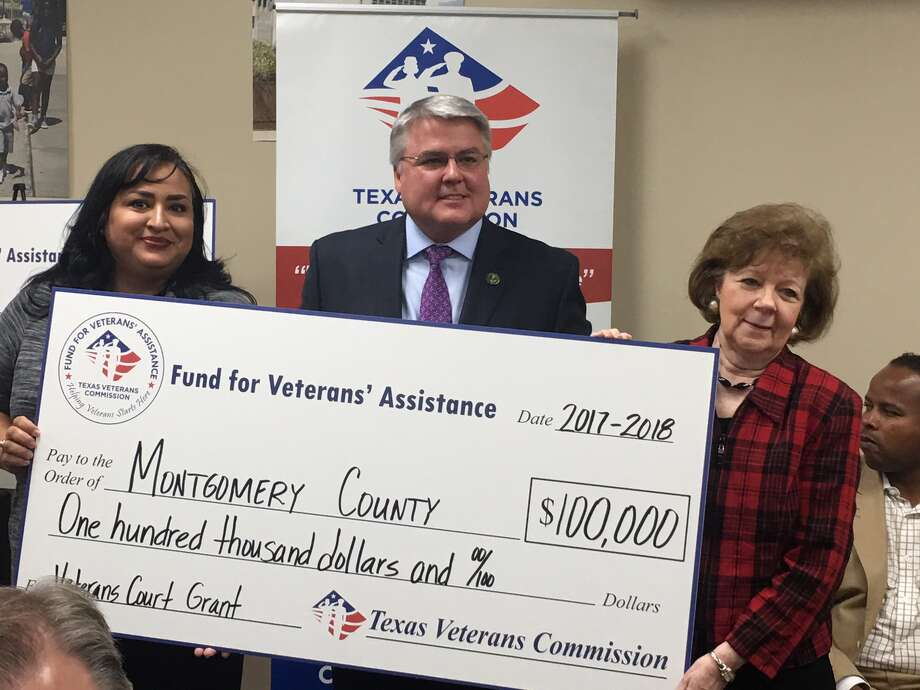 Montgomery County Veterans Treatment Court Coordinator Josie Iracheta, left, poses with Texas Veterans Commission Commissioner Kevin Barber and 359th state District Court Judge Kathleen Hamilton during a check presentation Oct. 26, 2017, in Houston. The Texas Veterans Commission awarded a $100,000 grant to Montgomery County's Veterans Treatment Court in May. Photo: Submitted Photo