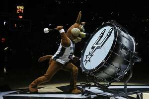 The San Antonio Spurs Coyote entertains before Game 3 of the Western Conference Finals between the San Antonio Spurs and Golden State Warriors May 20 at the AT&T Center. Part of the most current Spurs logo is shown on his drum.