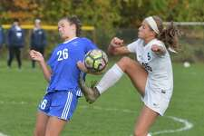 Staples #25 Marlo Von der Ahe gets a foot on the ball against Fairfield Ludlowe's Maya Newton during Class LL girls soccer action at Staples High School on Thursday November 9, 2017 in Westport Conn.