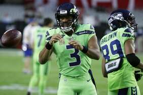 Seattle Seahawks quarterback Russell Wilson (3) warms up prior to an NFL football game against the Arizona Cardinals, Thursday, Nov. 9, 2017, in Glendale, Arizona.