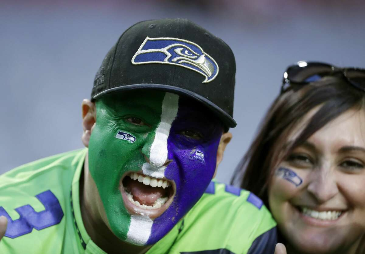 Seattle Seahawks fans cheer prior to an NFL football game against the Arizona Cardinals, Thursday, Nov. 9, 2017, in Glendale, Ariz. (AP Photo/Rick Scuteri)