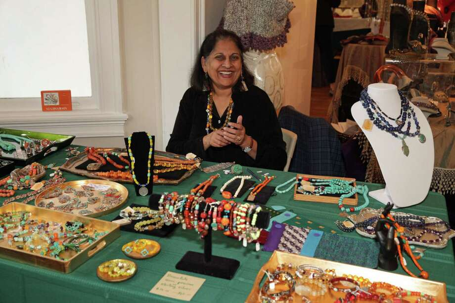 Greenwich resident Chitra Ramcharandas sells goods from Adornments at last year's Woman's Club of Greenwich  holiday boutique. Photo: Scott Chaney/Contributed Photograph
