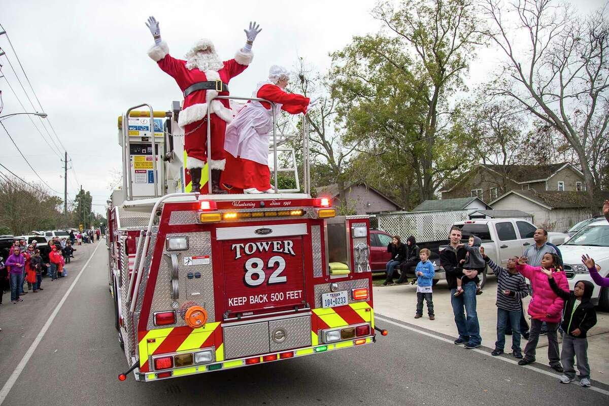Santa and Mrs. Claus wave to the crowd during the Crosby Christmas Festival and Parade sponsored by the Crosby-Huffman Chamber of Commerce on Dec. 14, 2013, at the Crosby Fairgrounds. (Photo by ANDREW BUCKLEY/The Observer)