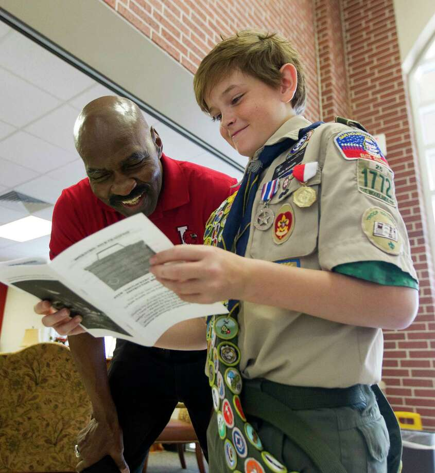 Rafe Kotalik, a with Boy Scouts of America Troop 1772, shows Gerald Irons directors for a STEM project, part of 20 different boxes containing 10 separate projects he assembled for students at Irons Junior High School to complete his Eagle Scout project, Thursday, Nov. 9, 2017, in Conroe. Photo: Jason Fochtman, Staff Photographer / © 2017 Houston Chronicle