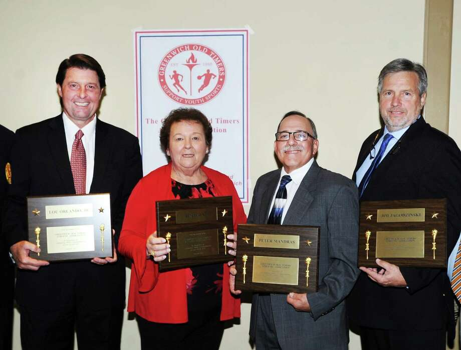 The Greenwich Old Timers Athletic Association 57th annual Awards Dinner local honorees from left, Lou Orlando Jr., Bea Walko, Peter Mandras and Jim Jagodzinski, shown here at Hyatt Regency Greenwich in Conn., Thursday night, Nov. 9, 2017. The national honorees were former New York Mets star Howard Johnson and New York Giant Super Bowl XLVI team member Mark Herzlich. The Greenwich Old Timers Athletic Association's mission is to contribute to youth sports and programs that use sport to augment their services. Funds raised by the organization go to individual scholarships and provide financial assistance to local families and their children so they may participate in local athletic programs. Photo: Bob Luckey Jr. / Hearst Connecticut Media / Greenwich Time