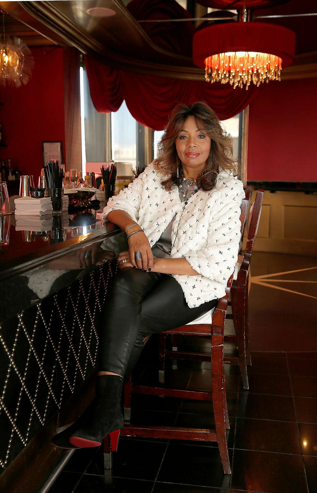 Stylist Sheree Chambers, of Wilkes Bashford clothing store. She is seen in a vintage holiday sweater, a Brunello Cucinelli silk tank, leather pants by the Row, and Christian Louboutin black suede boots.