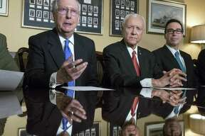 From left, Senate Majority Leader Mitch McConnell, R-Ky., Senate Finance Committee Chairman Orrin Hatch, R-Utah, and Treasury Secretary Steven Mnuchin, make statements to reporters as work gets underway on the Senate's version of the GOP tax reform bill, on Capitol Hill in Washington, Thursday, Nov. 9, 2017.