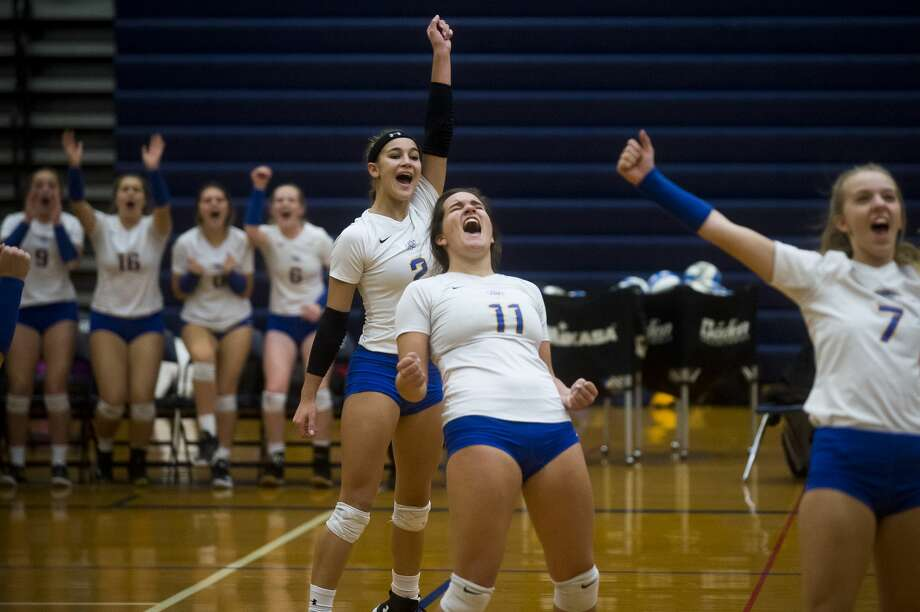 Midland senior Peyton Gerstacker (2), senior Alexandria McMath (11), and senior Hailey Werth (7) celebrate a point during the Chemics' Class A regional final against Fenton on Thursday, Nov. 9, 2017 at Saginaw Heritage High School. (Katy Kildee/kkildee@mdn.net) Photo: (Katy Kildee/kkildee@mdn.net)