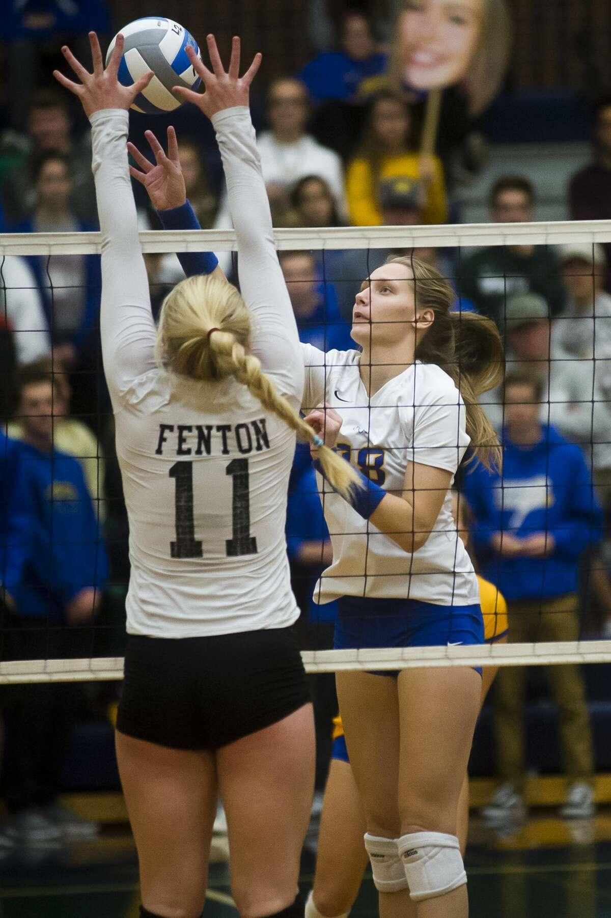 Midland senior Bethany Wilson tips the ball over the net during the Chemics' Class A regional final against Fenton on Thursday, Nov. 9, 2017 at Saginaw Heritage High School. (Katy Kildee/kkildee@mdn.net)