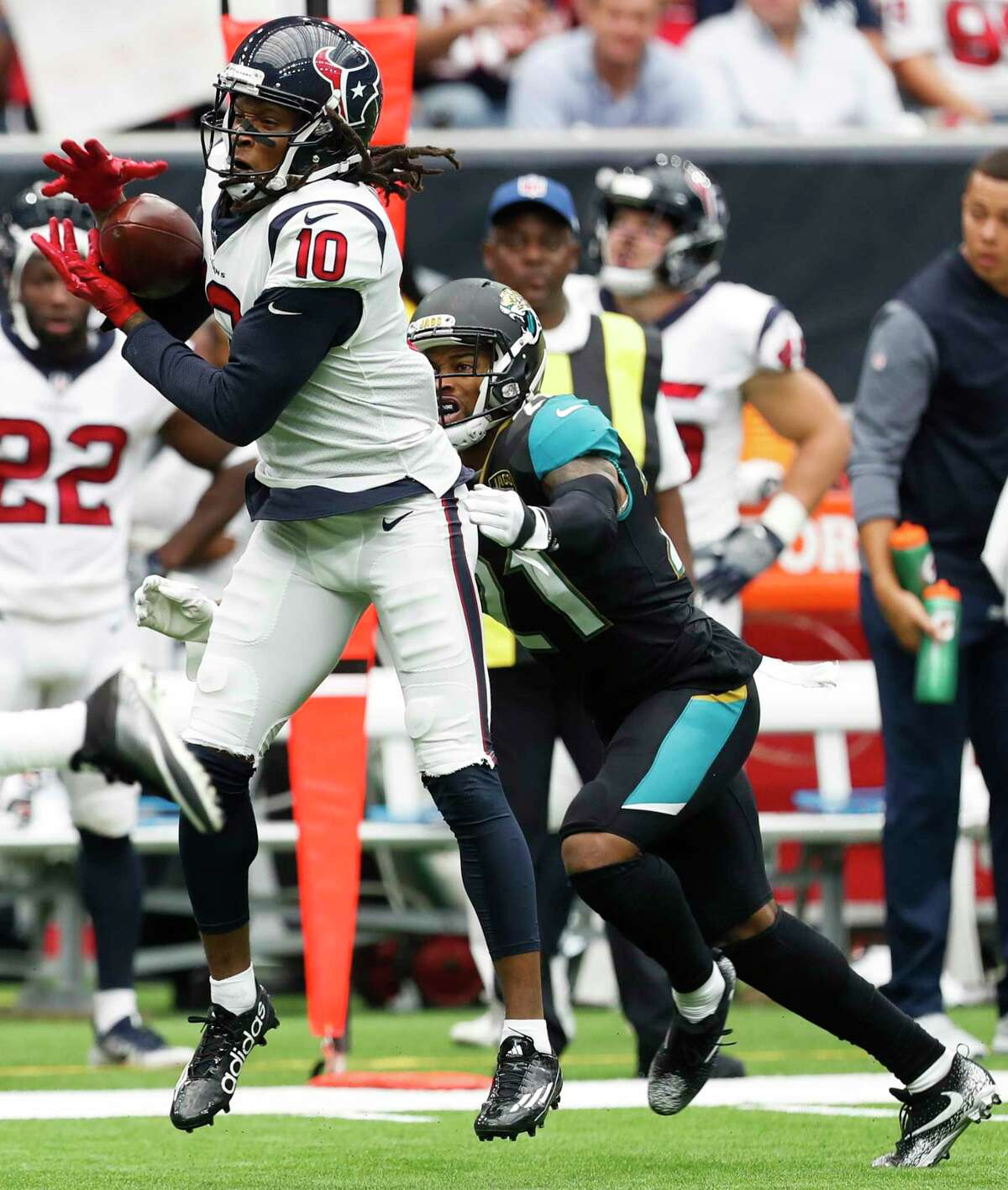 Texans receiver DeAndre Hopkins, left, makes a catch in front of Jaguars cornerback A.J. Bouye during Jacksonville's win in the season opener.
