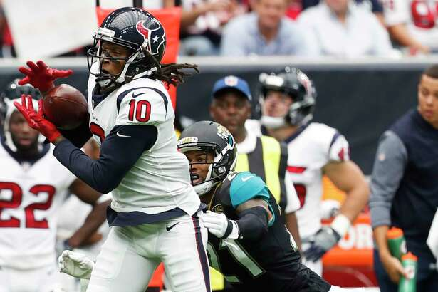 Houston Texans wide receiver DeAndre Hopkins (10) makes a catch in front of Jacksonville Jaguars cornerback A.J. Bouye (21) during the second quarter of an NFL football game at NRG Stadium on Sunday, Sept. 10, 2017, in Houston. ( Brett Coomer / Houston Chronicle )