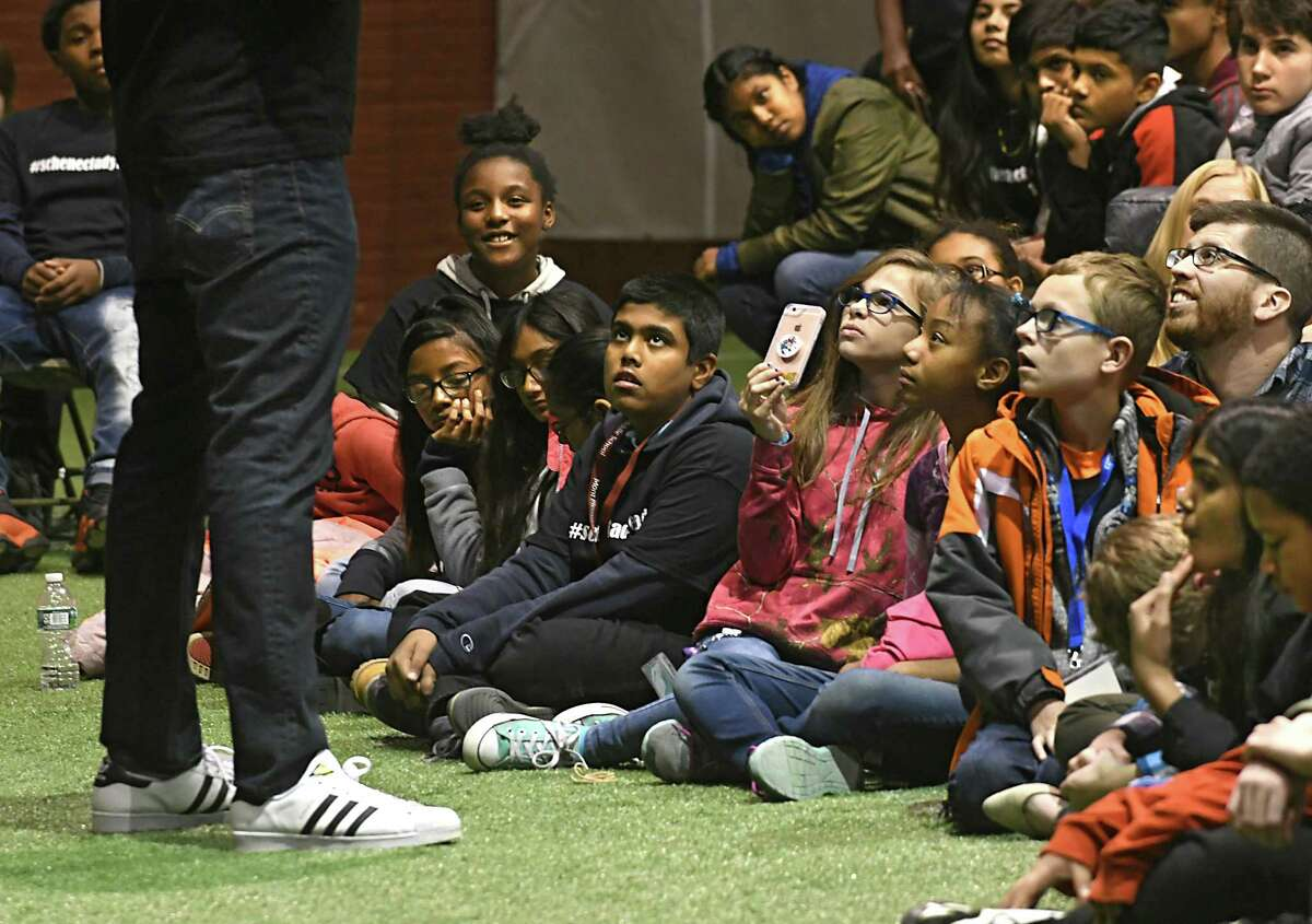Author and poet Kwame Alexander, left, holds a literary pep rally with Schenectady City School District students at the Schenectady Armory on Thursday, Nov. 9, 2017 in Schenectady, N.Y. Musician Randy Preston, right, plays guitar and sings. (Lori Van Buren / Times Union)