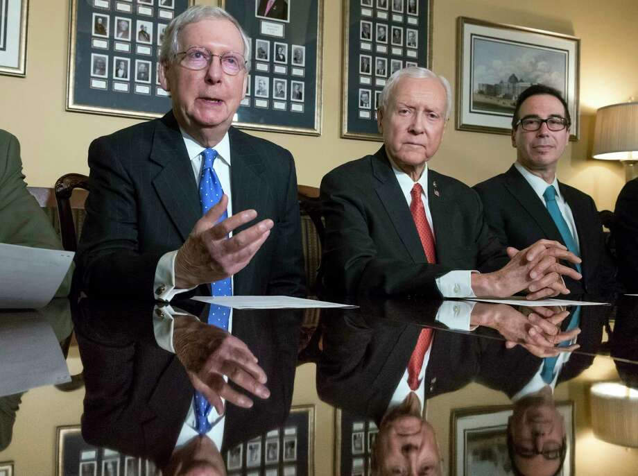 From left, Senate Majority Leader Mitch McConnell, R-Ky., Senate Finance Committee Chairman Orrin Hatch, R-Utah, and Treasury Secretary Steven Mnuchin, make statements to reporters as work gets underway on the Senate's version of the GOP tax reform bill, on Capitol Hill in Washington, Thursday, Nov. 9, 2017. (AP Photo/J. Scott Applewhite) Photo: J. Scott Applewhite, STF / Copyright 2017 The Associated Press. All rights reserved.