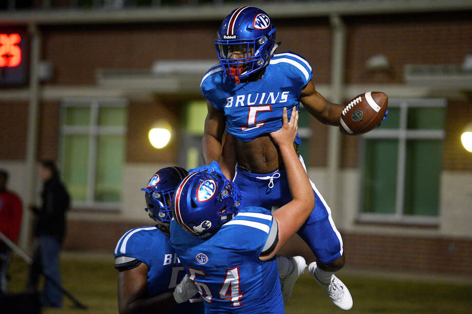 Beaumont West Brook running back James Jones (5) is lifted into the air by Beaumont West Brook offensive linemen Kendall Major (64) after a touchdown against Conroe at the Thomas Center on Thursday night.  Photo taken Thursday 11/9/17 Ryan Pelham/The Enterprise Photo: Ryan Pelham / ©2017 The Beaumont Enterprise/Ryan Pelham