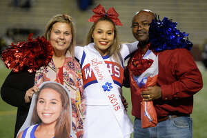 West Brook cheerleader Maci Cauley with parents Michelle and Cedrick for senior night before the game against Conroe at the Thomas Center on Thursday night.  Photo taken Thursday 11/9/17 Ryan Pelham/The Enterprise
